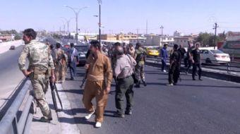 rak ordusu ve federal polis güçleri sabahın erken saatlerinde güneyden ilerleyerek, K1 Askeri Üssü,