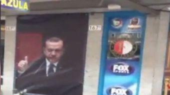 Türk kökenli bir işletmeci, dükkanının kapatılmasına Recep Tayyip Erdoğan posterleriyle tepki göster