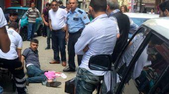 Bursa'da şehrin en işlek caddesinde yaşanan silahlı kavga çevredeki bir iş yerinin güvenlik kamerala