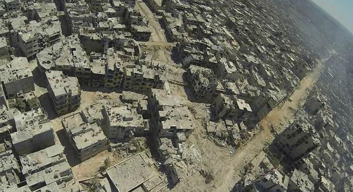Esed rejiminden Humus'a hava saldırısı