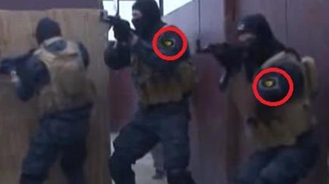 Afrin'de öldürülen teröristin kıyafetindeki peç detayı