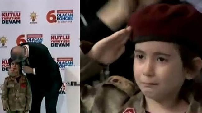 Cumhurbaşkanı Erdoğan, bordo bereli bir kız çocuğunu sahneye çağırarak alnından öptü
