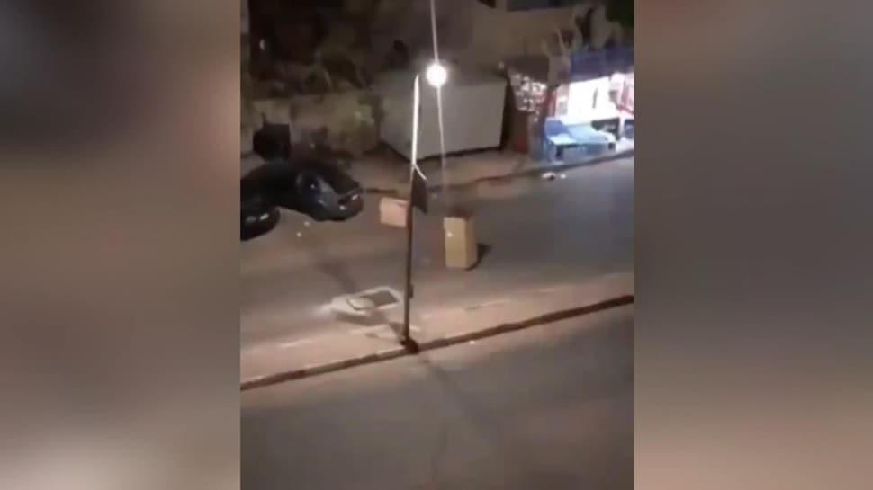 Sokağa çıkma yasağı onu durduramadı! Polise yakalanmamak için üzerine karton geçirdi